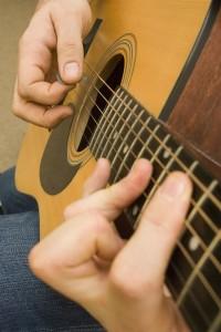 Strumming and fingerpicking guitar chords